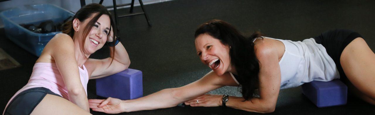 energy-fitness-brandy-and-tonya-on-blocks-laughling-1280x393.jpg